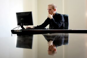 man searching online for best states for IT entrepreneurs