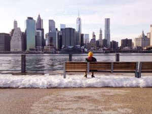 Man sitting and looking at the NYC skyline