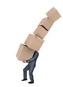 A man carrying moving boxes