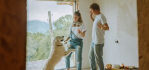 A couple with their dog while remodeling a home.