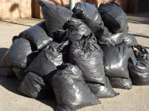 A pile of black trash bags.