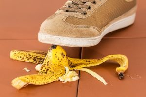 a person stepping on a banana