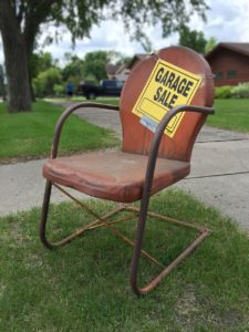 "An old chair with a ""garage sale"" sign on it - how to be efficient when packing for a move"