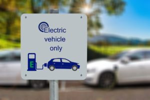 A sign for electric vehicle - Eco-friendly moving tips