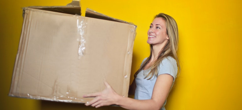 Pack your apartment overnight- a girl holding a box