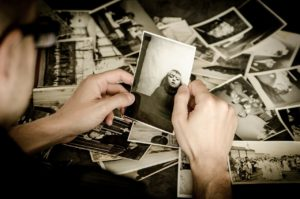 person looking at an old picture
