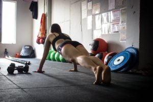 woman exercising in a garage