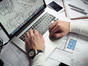 person looking at a floor plan