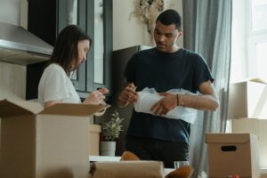 man and woman packing - low cost move to Soho