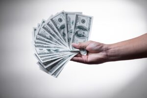 A man holding money - read our guide to make your interstate move cheaper