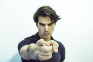 A man pointing a finger at someone