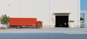 red truck in front of a warehouse