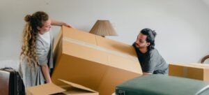 Picture of a couple packing boxes for the move