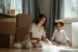 woman and daughter picking up bubble wrap