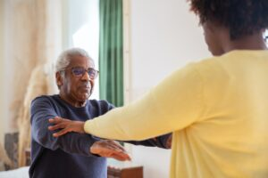 nurse and an older person working out