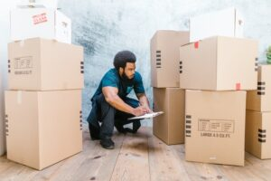a man writing - manage the stress of moving house