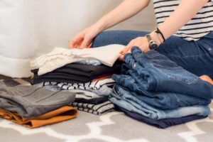A woman packing her clothes
