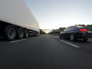 A car and truck in traffic