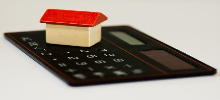 A house on a calculator - perfect time to count Park Slope moving costs is before the move