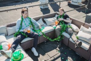 A couple of guys after a party sitting around on the roof
